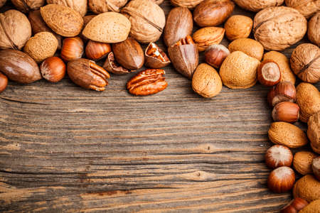 Assortment of hard shell nuts on wooden background Stock Photo - 17653087
