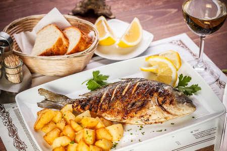 dorado: Dorado fish served on restaurant table Stock Photo