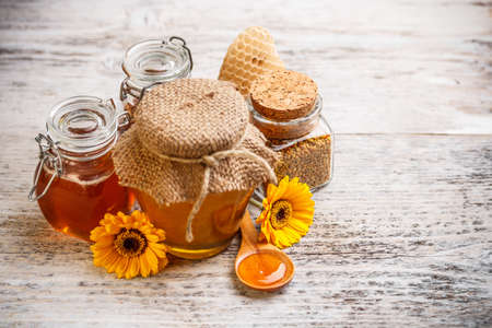 Still life of jars of honey and pollen photo