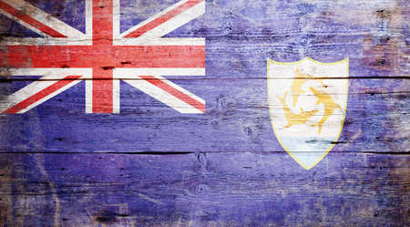Flag of Anguilla painted on grungy wood plank background photo