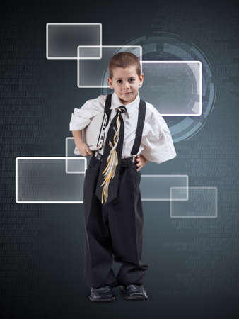 Little  boy dressed in oversized business clothes on digital background photo