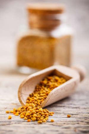 Bee pollen granules in wooden scoop Stock Photo - 17783866