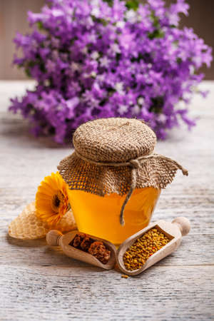 Acacia honey with apiary product in spoon Stock Photo - 17783890