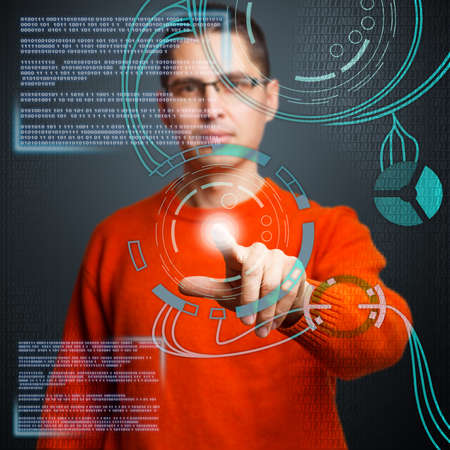 touch screen hand: Young man pressing high tech type of modern buttons Stock Photo