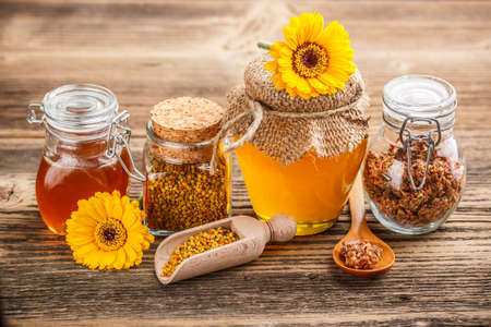 Still life of jars of honey, pollen and propolis with a spoon Stock Photo - 17783886