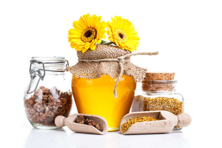 Still life of jars of honey, pollen and propolis photo