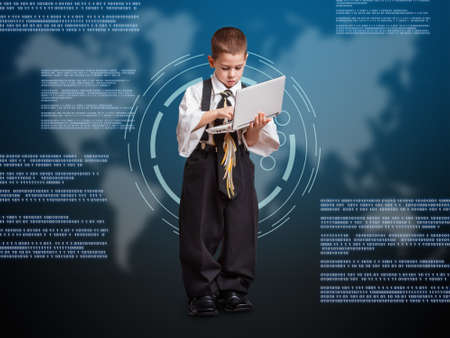 Little business boy working with laptop and virtual buttons on digital background photo