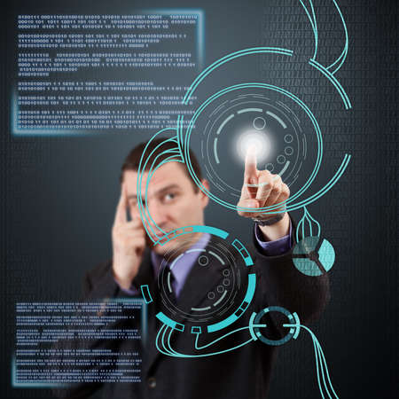Businessman pressing modern buttons on a virtual interface Stock Photo - 17668684
