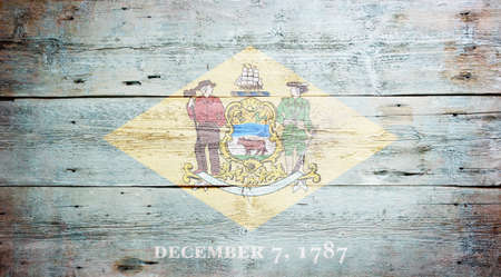 Flag of Delaware painted on grungy wooden background Stock Photo - 17786928