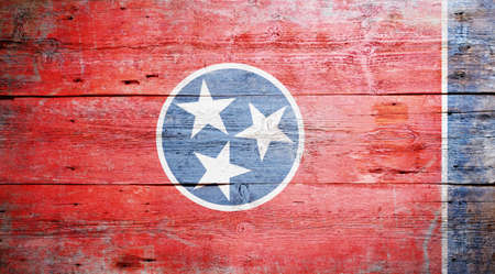 Flag of Tennessee painted on grungy wooden background photo
