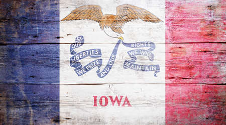 Flag of Iowa painted on grungy wooden background Stock Photo - 17786908