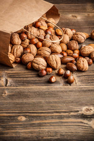 Various nuts mix on wooden background Stock Photo - 17786771