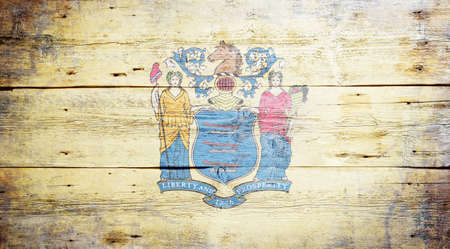 Flag of New Jersey painted on grungy wooden background Stock Photo - 17786909