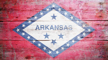 Flag of Arkansas painted on grungy wooden background Stock Photo - 17786935