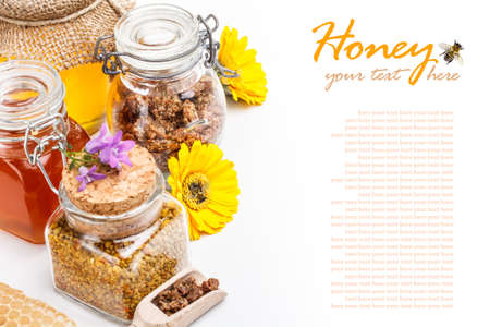 Still life of fresh honey, pollen and propolis on white background photo
