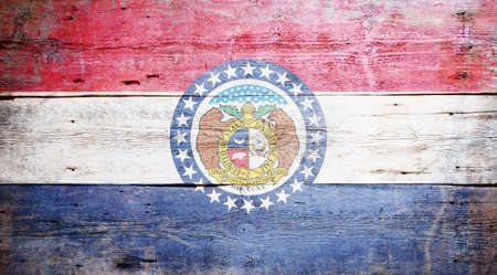 Flag of Missouri painted on grungy wooden background Stock Photo - 17786934