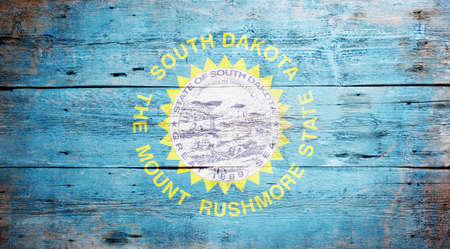 Flag of South Dakota painted on grungy wooden background Stock Photo - 17789585
