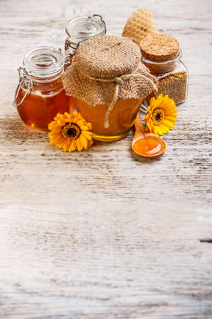 Still life of fresh honey on the wooden table  photo