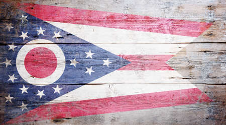 Flag of Ohio painted on grungy wooden background Stock Photo - 17786930
