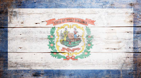 Flag of the state of West Virginia painted on grungy wooden background Stock Photo - 17787753