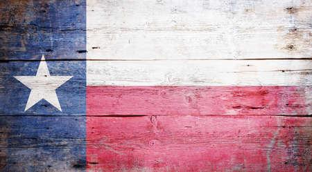 汚れた木製の背景に描かれたテキサスの州の旗 写真素材