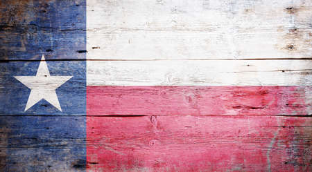 Flag of the State of Texas painted on grungy wooden background Stock Photo