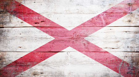Flag of Alabama painted on grungy wooden background Stock Photo - 17787755