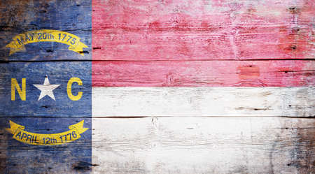 Flag of the state of North Carolina painted on grungy wooden background Stock Photo - 17962178