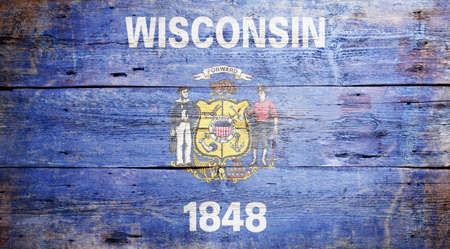 wisconsin flag: Flag of the state of Wisconsin painted on grungy wooden background