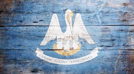 louisiana flag: Flag of Louisiana painted on grungy wooden background
