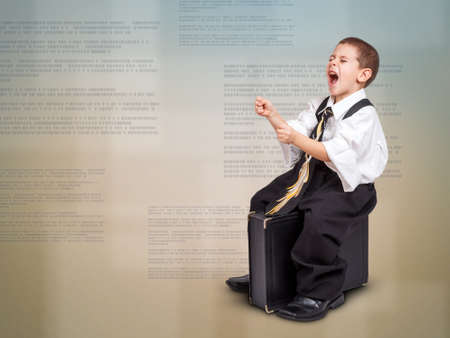 Business concept with boy sitting on a briefcase, leads to success  photo