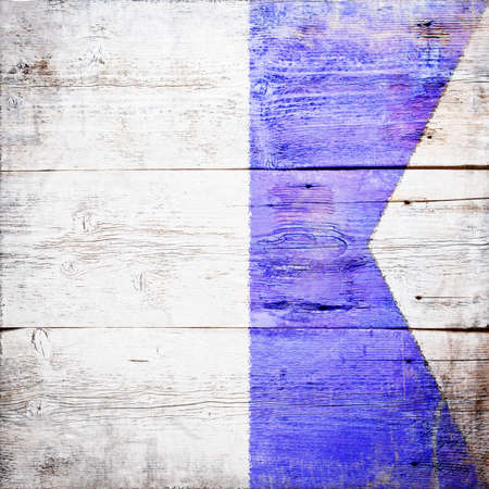 Alfa, international maritime signal flag painted on grungy wood plank background  photo