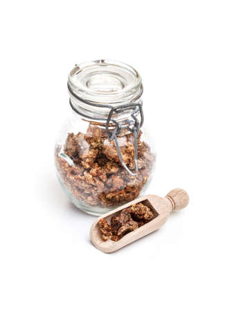 Propolis in a glass pot on white background 写真素材