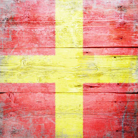 Romeo, international maritime signal flag painted on grungy wood plank background  photo
