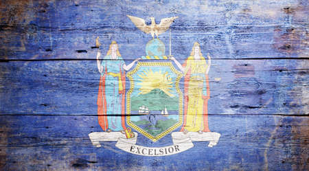 Flag of the State of New York painted on grungy wooden background photo