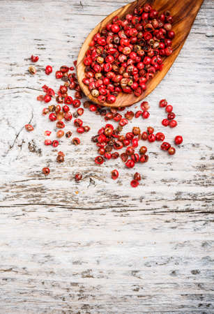 wooden spoon: Red pepper on wooden spoon, rustic wood table