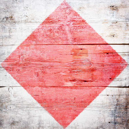 Foxtrot, international maritime signal flag painted on grungy wood plank background  photo