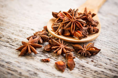 herbe: Close up of star anise on wooden board