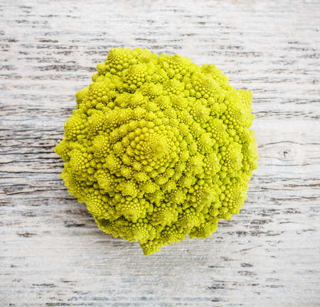 romanesco: Raw Romanesco broccoli on wooden background