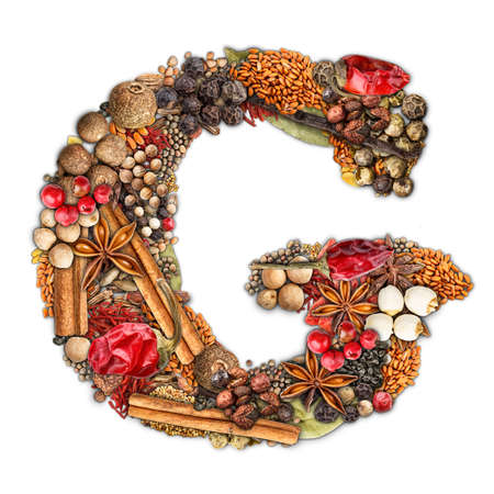 Letter G made of spices isolated on white background  photo