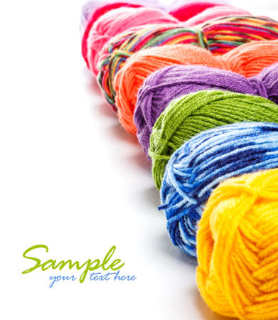 Multicolored yarns in a row with space for your text photo