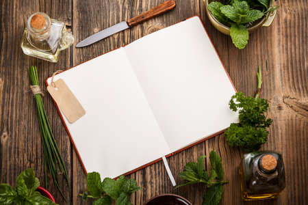 Blank cookbook for recipes with herbs photo