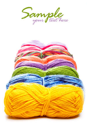 Multicolored yarns in a row photo