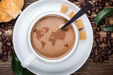 World map in coffee cup photo