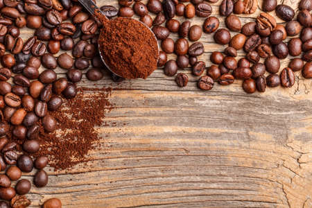 grinded: Roasted coffee beans on wooden background