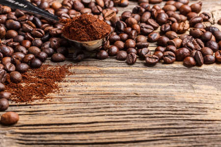 grinded: Coffee in measurement spoon with coffee beans Stock Photo