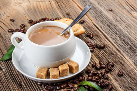 lump: Coffee cup with fresh coffee beans and lump sugar Stock Photo