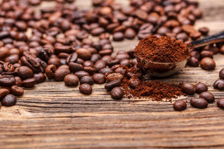 grinded: Fresh coffee beans on wooden background