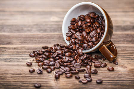 coffee spill: Coffee beans in coffee cup  Stock Photo