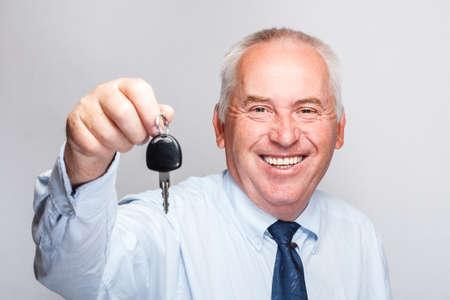 Portrait of smiling businessman holding car key photo